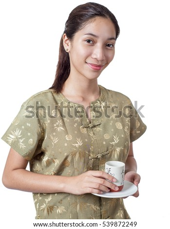 Portrait of a chinese lady holding a cup of tea. Isolated in white background.