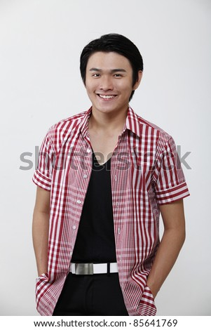 portrait of a chinese man with smile - stock photo