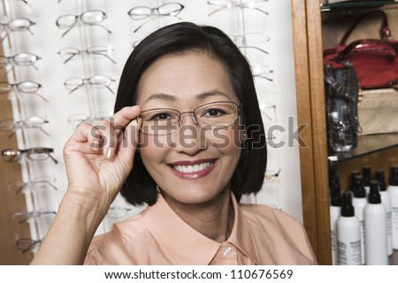 Portrait of a Chinese woman wearing glasses