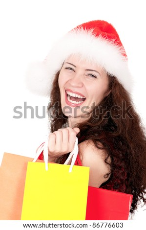 Portrait of a Christmas woman in santa hat holding a shopping bags over white background