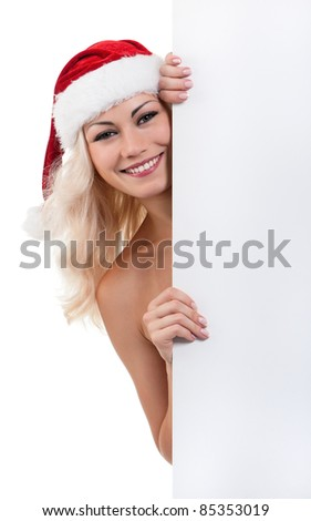Portrait of a Christmas woman in santa hat with blank billboard on white background - stock photo