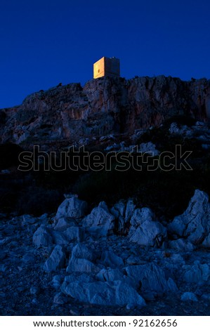 Portrait of a cliff, photographed during the blue hour. - stock photo
