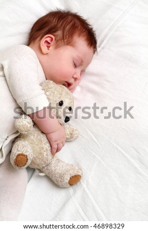 portrait of a close-up, infant lying on the bed - stock photo