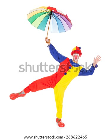 Portrait Of A Clown With Multi Coloured Umbrella Over White Background - stock photo