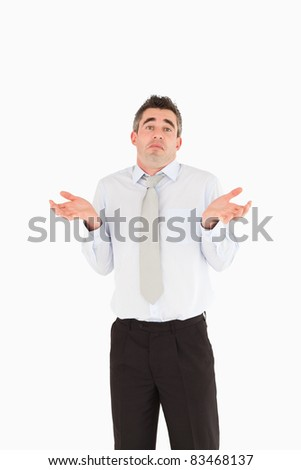 Portrait of a clueless businessman posing against a white background - stock photo