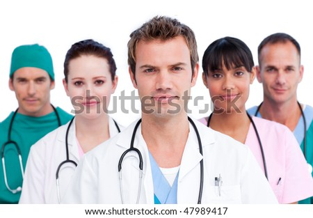 Portrait of a concentrated medical team against a white background