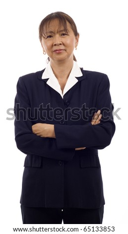 Portrait of a confident and serious looking senior Asian business woman with arms folded isolated over white background - stock photo