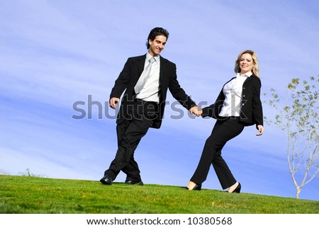 portrait of a confident and successful business partners running in the field