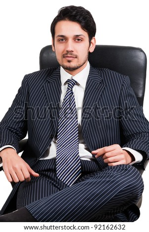 portrait of a confident Arab businessman sitting on a chair, biracial businessman isolated on white - stock photo