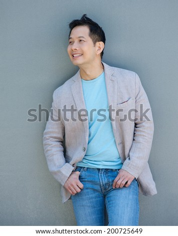 Portrait of a confident asian man smiling outdoors - stock photo