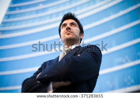 Portrait of a confident business man in front of a modern building
