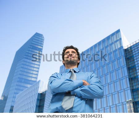 Portrait of a confident business man in front of a modern building - stock photo