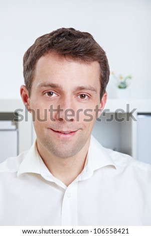 Portrait of a confident business man in his office - stock photo