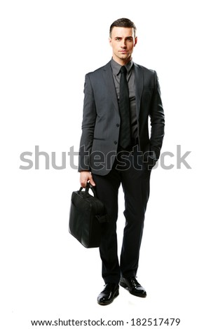 Portrait of a confident businessman with bag isolated on a white background