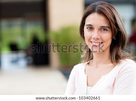Portrait of a confident casual woman smiling - stock photo