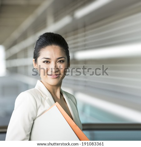 Portrait of a confident Chinese business woman. Happy Asian businesswoman. - stock photo