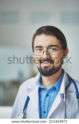 Portrait of a confident gp smiling at camera - stock photo