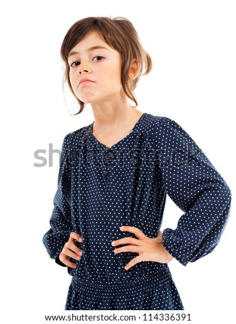 Portrait of a confident little girl with hand on hips isolated on white