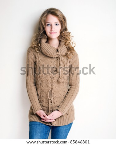 Portrait of a confident looking winter fashion girl. - stock photo