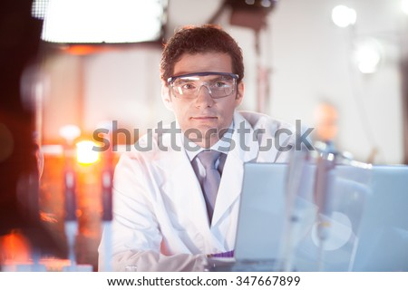 Portrait of a confident male engineer in his working environment. Science and technology concept. - stock photo