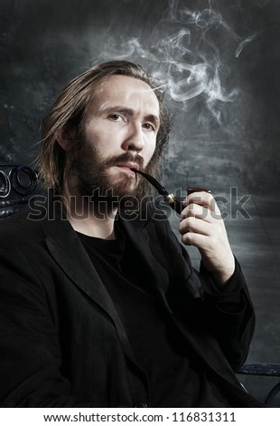 Portrait of a confident man smoking his tobacco pipe