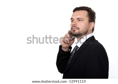 Portrait of a confident mature business man in black suit communicating using mobile phone over white background - stock photo