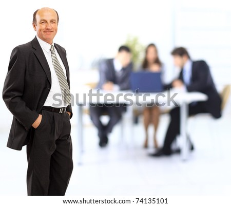 Portrait of a confident mature businessman standing in the office - Indoor - stock photo