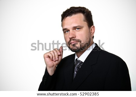 Portrait of a confident mature Caucasian business man on white background - stock photo