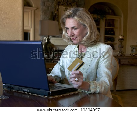 portrait of a confident mature woman shopping on internet