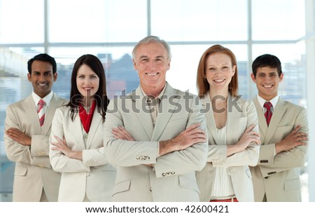 Portrait of a confident multi-ethnic business team in a business building - stock photo