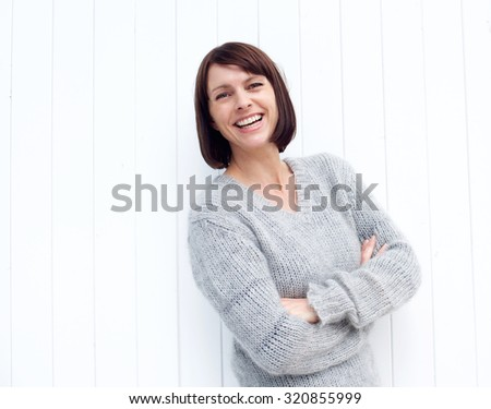 Portrait of a confident older woman smiling against white background - stock photo