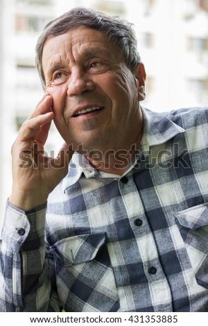 Portrait of a confident senior man smiling - stock photo