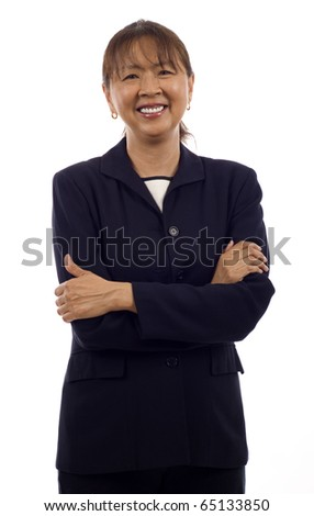 Portrait of a confident smiling senior Asian business woman with arms folded isolated over white background