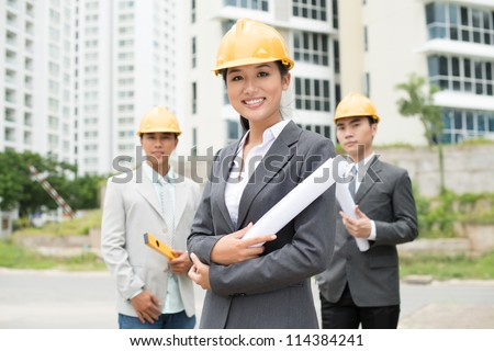Portrait of a confident team of architects with a female leader in chief - stock photo