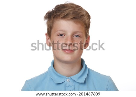 Portrait of a confident teenage boy on white background