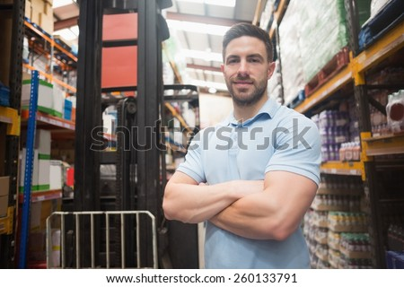 Portrait of a confident worker smiling in the warehouse