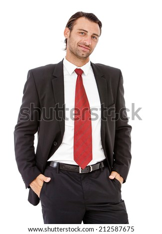Portrait of a confident young business man in a black suit posing over white. - stock photo
