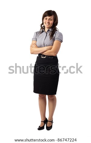 Portrait of a confident young business woman standing with folded hands, isolated over white background - stock photo