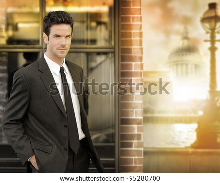 Portrait of a confident young businessman out in the city in golden light - stock photo