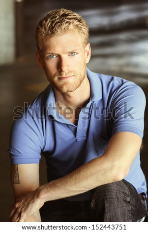 Portrait of a confident young guy - stock photo