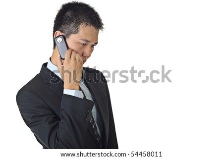 Portrait of a confident young male businessman talking on cellphone with copyspace.