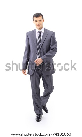 Portrait of a confident young male entrepreneur walking on white background - stock photo