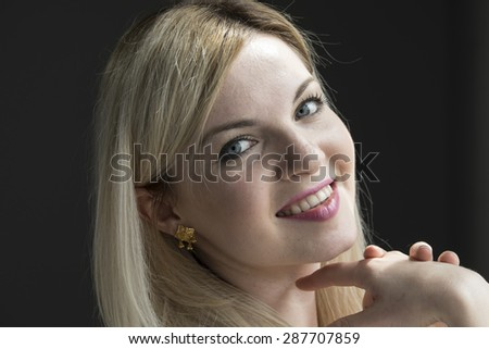Portrait of a confident young woman - stock photo