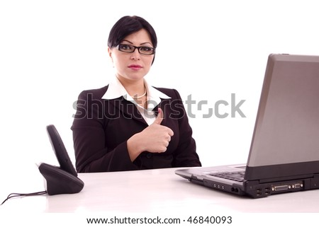 Portrait of a content beautiful business woman  showing the perfect sign sitting at her desk isolated over white background