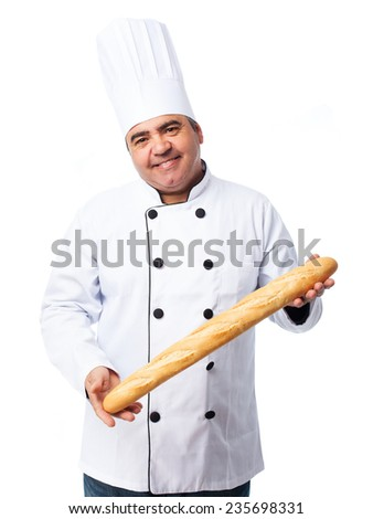 portrait of a cook man holding a bread bar - stock photo