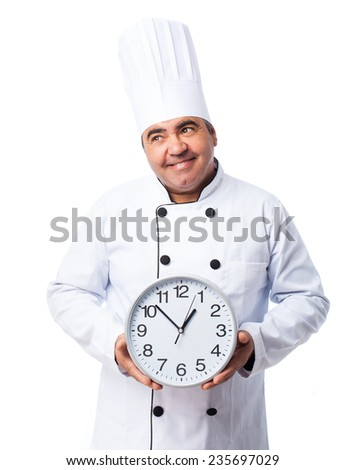 portrait of a cook man holding a clock - stock photo