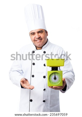 portrait of a cook man holding a scale - stock photo