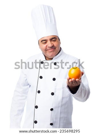 portrait of a cook man holding an orange - stock photo