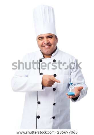 portrait of a cook man showing his sand timer - stock photo