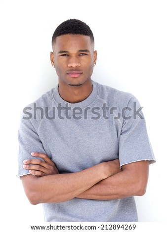 Portrait of a cool african american man posing with arms crossed - stock photo